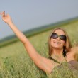 Woman with glasses in the field — Stock Photo #4722535