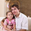 Father with a daughter at homes - Stockfoto