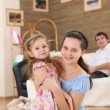 Young mother with a daughter at home - Stock Photo