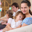 Young family at home with a daughter - Stockfoto