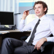 Stock Photo: Young businessmin office