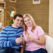 Couple with glasses of champagne at home — Stock Photo