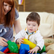 Young mother playing with her little son — Stock Photo #4729549