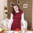 A young girl cooking at home — Stock Photo #4729586