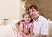 Young family at home with a daughter — Stock Photo
