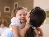 Young mother with a daughter at home — Stock Photo