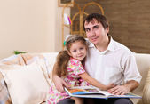 Young family at home with a daughter — Стоковое фото