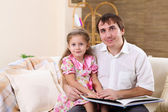 Young family at home with a daughter — Foto Stock