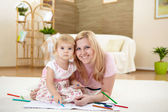 Mother with her little daughter at home — Stock Photo
