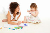 Young mother having fun with her little son — Stock Photo