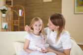 Mother with teenager daughter at home — Stock Photo