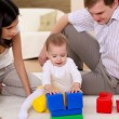 Young family at home playing with a baby — Stock Photo #4731186