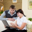 Couple with a laptop at home — Stock Photo
