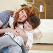 Young mother playing with her little son — Stock Photo #4731210