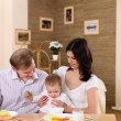 Young family at home having meal — Stock Photo #4731217