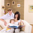Young family at home playing with a baby — Stock Photo #4731225