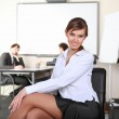 Young business woman in office — Stock Photo