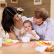 Young family at home having meal — Stock Photo #4731570