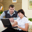 Couple with a laptop at home — Stock Photo #4732045