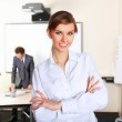 A young business woman in office — Stock Photo