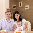 Young family at home having meal — Stock Photo #4734407
