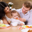 Young family at home having meal — Stock Photo #4734436