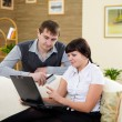 Couple with a laptop at home — Stock Photo #4734515