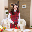 A young girl cooking at home — Stock Photo #4735883