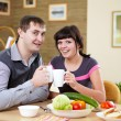 Couple at home having meal — Stock Photo