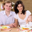 Young family at home having meal — Stock Photo #4735908