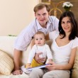 Young family at home playing with a baby — Stock Photo #4735918