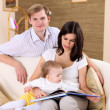 Young family at home playing with a baby — Stock Photo #4735952