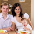 Young family at home having meal — Stock Photo #4736033