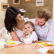 Young family at home having meal — Stock Photo #4736073