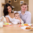 Young family at home having meal — Stock Photo #4736080