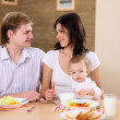 Young family at home having meal — Stock Photo #4736141