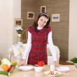 A young girl cooking at home — 图库照片