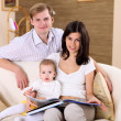 Young family at home playing with a baby — Stock Photo #4736223