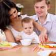 Young family at home having meal — Stock Photo #4736258