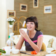 Young woman at home having meal — Stock Photo