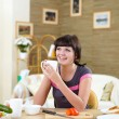Young woman at home having meal — Stock Photo #4736272