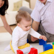 Young family at home playing with a baby — Stock Photo #4736370