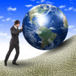 Business man with a globe — Stockfoto