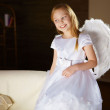 Girl in white dressed as an angel — Stock Photo #4736416