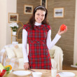 A young girl cooking at home — Stock Photo
