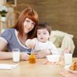 Mother feeding baby at home — Stock Photo #4736474