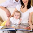 Young family at home playing with a baby — Stock Photo #4736578