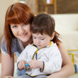 Young mother playing with her little son — Stock Photo