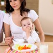 Young family at home having meal — Stock Photo #4737084