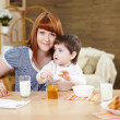Mother feeding baby at home — Stock Photo #4737545